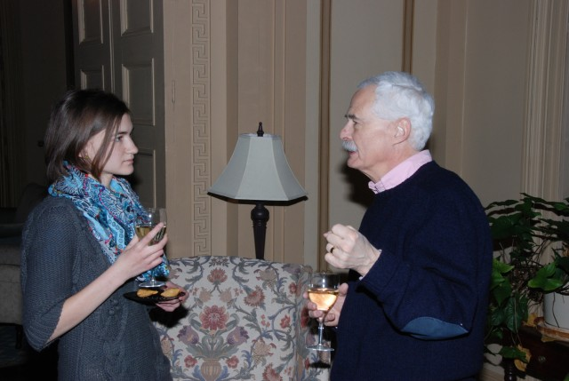 CPE volunteer Ali Ellerbeck '13 talks with Richard Adelstein, the Woodhouse/Sysco Professor of Economics and department chair. All CPE classes are taught by Wesleyan faculty members, with undergraduate students serving as TAs and writing assistants.