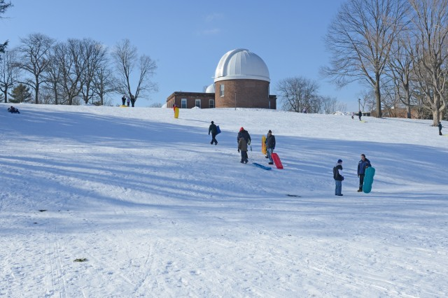 Local community members enjoy an afternoon of sledding on Foss Hill, Jan. 4.