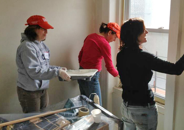 Lisanne Biolos '88, Sarah Williams '88 and Sharon Greenberger '88 paint walls at the Bowery Resident Council's Lex Safe Haven, a residence for 43 formerly homeless men and women in New York.