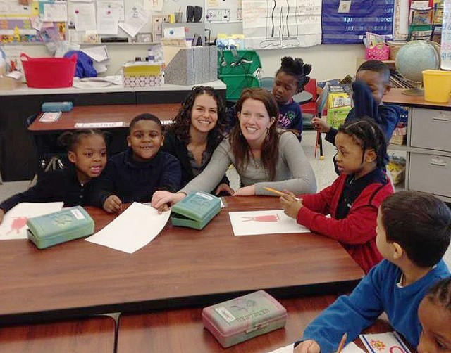 Makaela (Steinberg) Kingsley '98 read to kindergarteners in Mrs. Carter's class at the Celantano Museum Academy in New Haven, CT as part of the WEServe Week of Service.