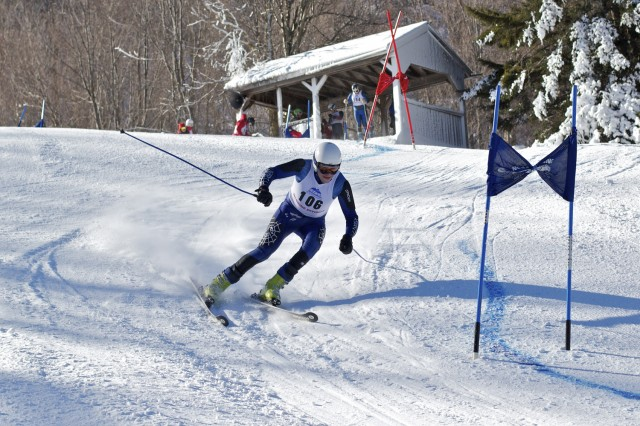 Chris Delaney '14 rounds the third gate of the Giant Slalom race at the Middlebury College Snow Bowl.