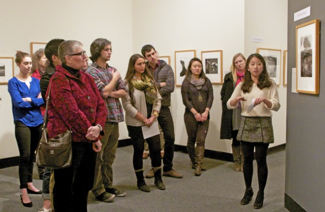 "The Davison Art Center's exhibit, ""(Re)viewing Bodies: Selected American Photographs, 1930-2000,"" opened on Feb. 7 in the DAC gallery. The show is curated by students who took the course ARHA 360, Museum Studies, taught in fall 2012 by Clare Rogan, curator of the Davison Art Center. Hyunjin Chelsey Cho '13, pictured, is one of the student curators who helped opening attendees navigate the gallery."