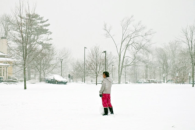 Mao Misaki '15 begins rolling a snowball on Andrus Field during the blizzard on Feb. 8.  (Photo by Dat Vu '15)