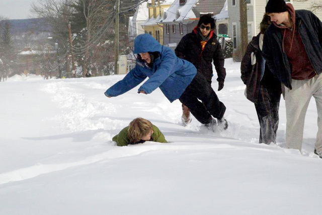 Students frolic in the snow near the Vine Street and Home Avenue intersection on Feb. 9.