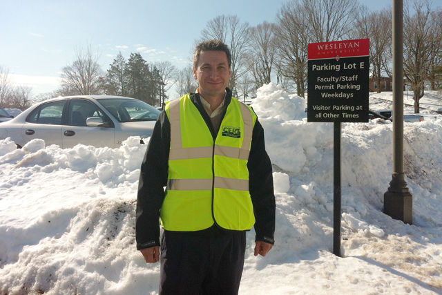 C-CERT members also assisted Wesleyan staff and faculty on Feb. 13 by directing them to open parking spaces. With a parking ban in effect, employees were not allowed to park on city streets. Wesleyan's Transportation Services offered shuttle rides for those parking away from campus. Pictured is Mario Velasquez, facilities manager at Physical Plant-Facilities, who manned parking lot E near Beckham Hall.