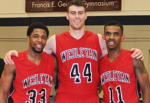 Basketball players, from left, Derick Beresford, Mike Callaghan and Shasha Brown celebrated their 1,000 point this year.