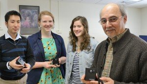 Psychology majors Julian Zhong '13, Ashley Swan '13 and Tacie Moskowitz '13 work with Professor of Psychology John Seamon in the Memory Lab at Wesleyan. The team is studying if a memory camera can help patients with Alzheimer's disease.