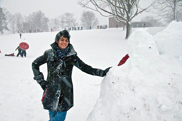 The snowbank is taller than Muniba Iqbal '15. (Photo by Dat Vu '15)