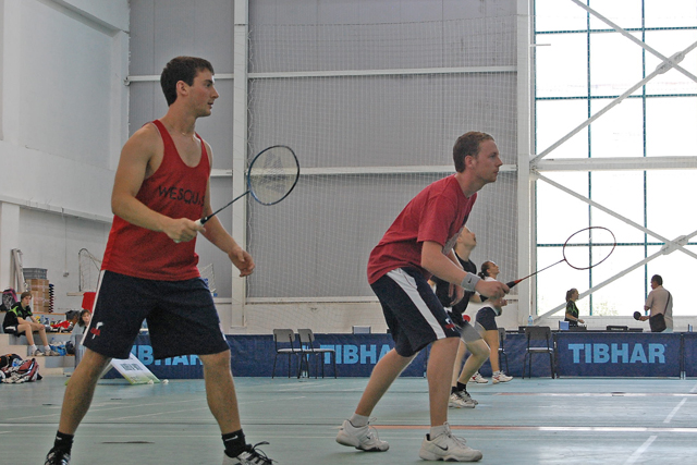 At left, Ethan Moritz '14 and his teammate Tim Schade compete in the badminton section of racketlon.