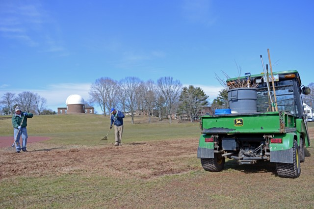 In preparation for the baseball team's first home game, the Wesleyan grounds crew raked and cleaned up a portion of Andrus Field and Dresser Diamond on March 15.