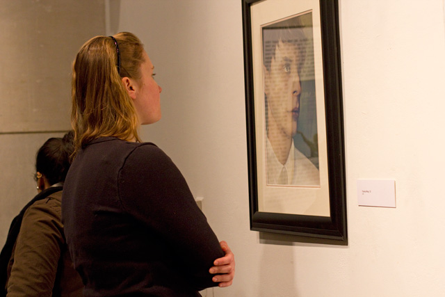 Miriam Kwietniewska '13 examines artwork on display.