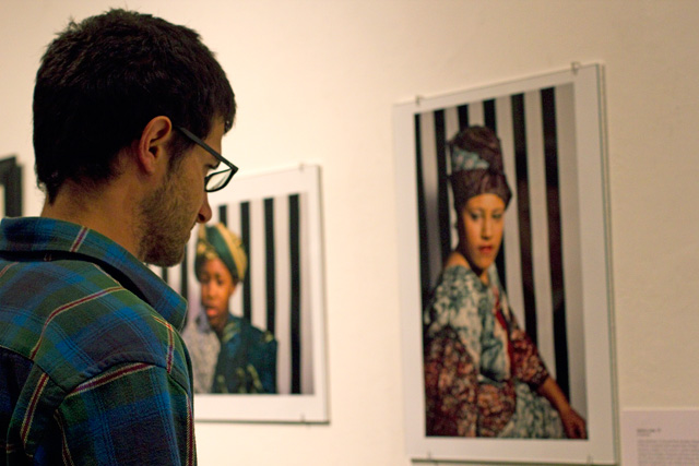 Greg Shaheen '13 looks at photographs taken by Sydney Lowe '13.