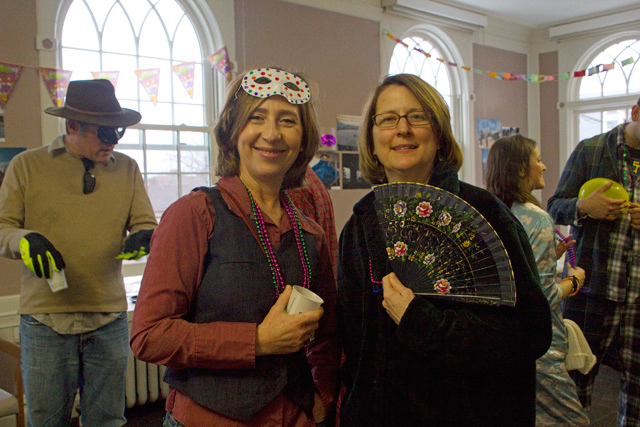 At left, Ana Perez-Girones, adjunct professor of romance languages and literatures, and Louise Neary, adjunct assistant professor of romance languages and literatures, enjoy the annual carnival.