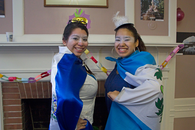 Adela Ramirez '13 and Stephanie Huezo '13 pose in their costumes at the carnival.