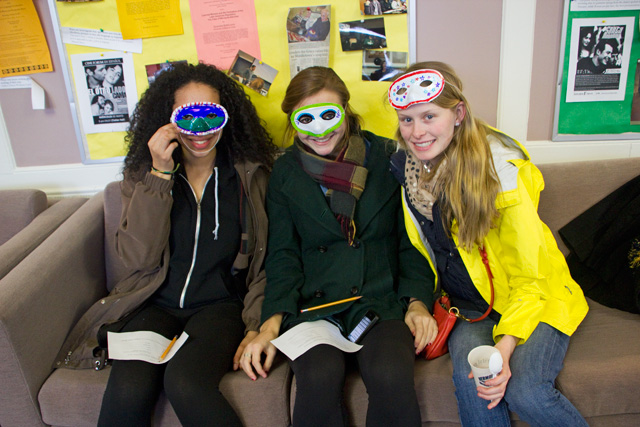 Alexandra Ricks '16, Micaela Kaye '16, and Alwyn Lansing '16 show off the masks they just made.