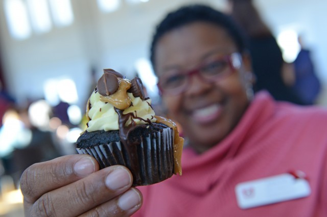 Andrea Kelly, program and events coordinator at at the Office of Admission, tries a peanut butter chocolate cupcake from Sweet Harmony Café and Bakery.