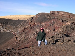 Christopher Kincaid 83 stands in a lava field in Oregon.