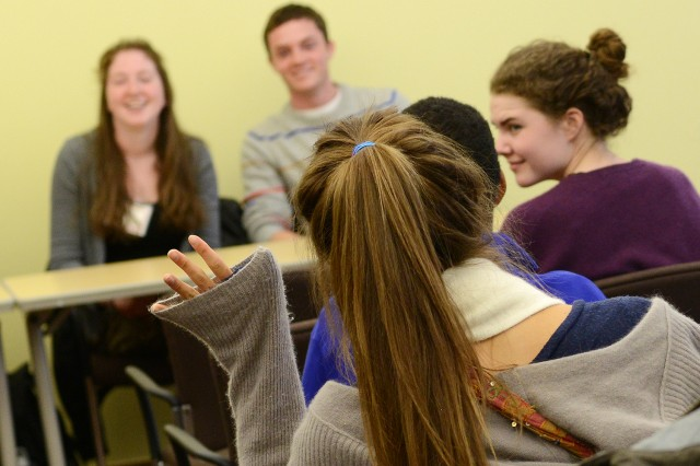 An admitted student asks about Wesleyan's faculty during another student-to-student panel.