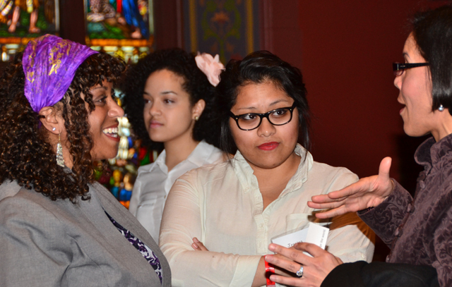 "Sonia Mañjon, at left, speaks with guests at the conference. Mañjon is the first person of color to be a vice president at Wesleyan. ""Networking is the way it happens for all of us,"" she said."