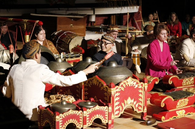 A gamelan (orchestra), using various combinations of instruments, is traditionally and essentially accompaniment to puppet shows, dances, feasts, and ceremonies in Java. Most of the instruments are bronze: tuned gongs, suspended vertically or horizontally; and instruments with tuned keys, suspended over tubular resonators or a resonant cavity in the base of the instrument