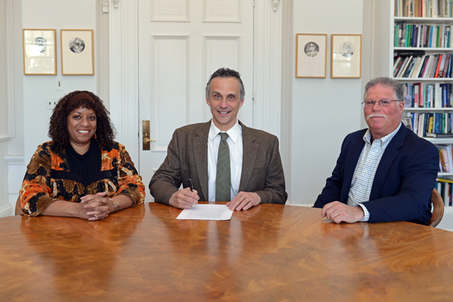 Wesleyan President Michael S. Roth signed an agreement between Wesleyan and Vermont Law School that guarantees admission for College of the Environment graduates meeting GPA and LSAT thresholds into Vermont's Environmental Law Program. At left, Sonia Mañjon, vice president for institutional partnerships and chief diversity officer, and at right, Barry Chernoff, director of College of the Environment, accompanied President Roth at the signing on April 3.