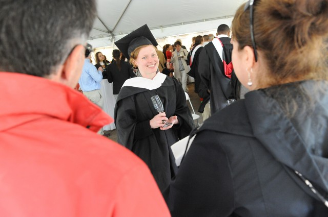 Wesleyan awarded 30 Master of Arts in Liberal Studies degrees. GLS graduates and guests received their diplomas and glasses of champagne in a reception at the Davidson Art Center on May 26. (Photo by Nick Lacy)