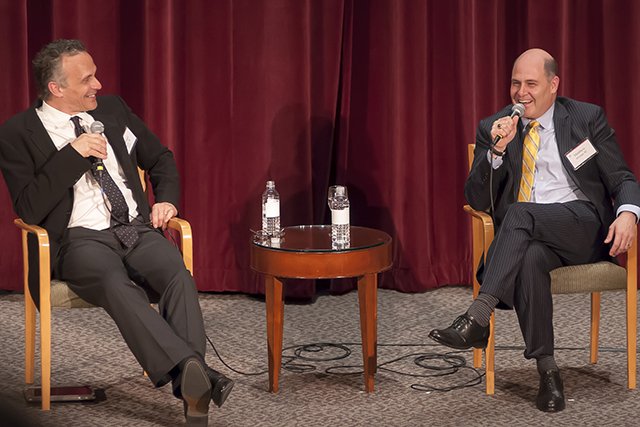 At left, Wesleyan President Michael Roth and Matt Weiner '87 speak at the recent fundraising event in NYC. 