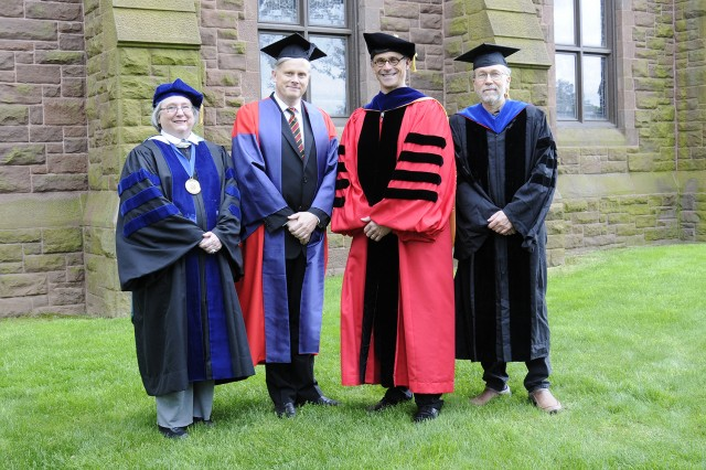Wesleyan faculty Jeanine Basinger, Erik Grimmer-Solem and Phillip Wagoner received Binswanger Prizes for Excellence in Teaching on May 26. They are pictured here with Wesleyan President Michael Roth, third from left.