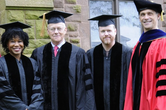 Wesleyan President Michael Roth, at right,  awarded Majora Carter '88, Jim Dresser '63 and Joss Whedon '87 with honorary degrees.