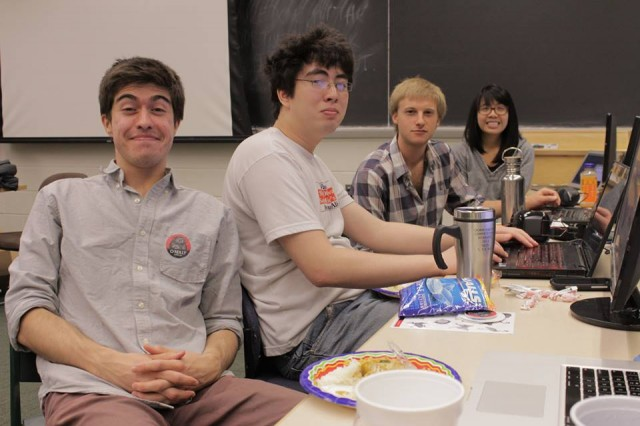 "Evan Carmi '13, Diego Calderon '13, Brian Gapinski '14, Lisa Sy '13 worked on the ""WesPeople"" app. (Photos by Bill Fisher)"