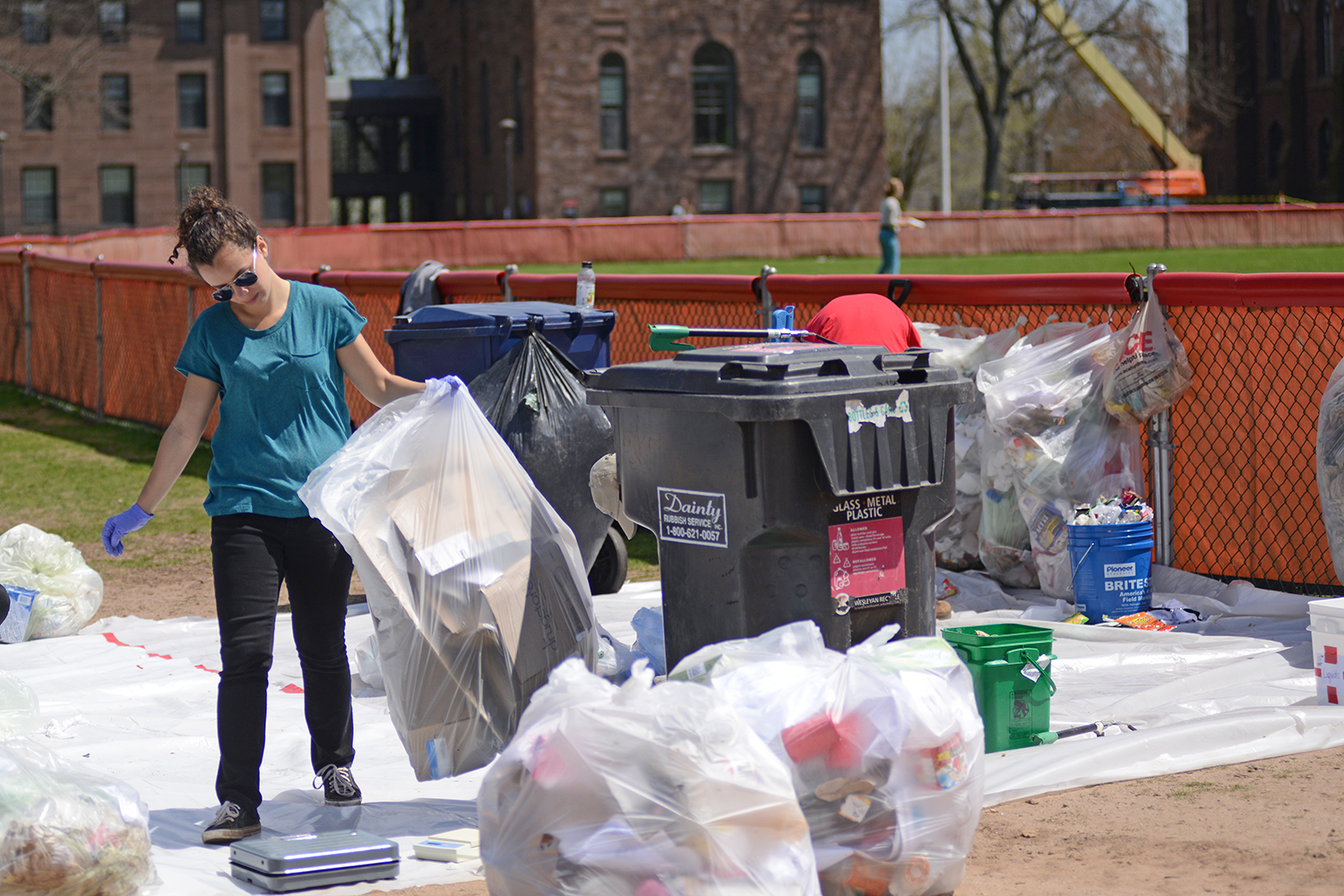 Sustainability staff and interns sorted trash and recycling from residence halls in order to investigate how to effectively reduce campus waste at the Residential Waste Audit on April 26.
