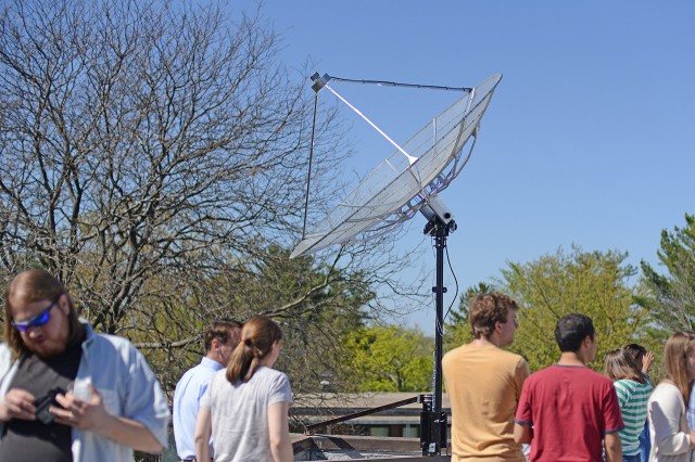Astronomy students and faculty celebrated the new small radio telescope (SRT) on May 1 during a ribbon-cutting ceremony. The SRT has a motorized arm that can position the dish to face any part of the sky.  Quasars, pulsars, and the afterglow of the Big Bang have all been discoveries of radio astronomy.