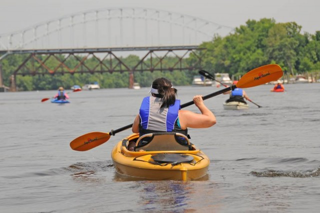 Kyle Beaudette, box office manager at the Center for the Arts, paddles up the Connecticut River. Beaudette and fellow paddlers collected garbage and debris from the rivers while on the three-hour journey.