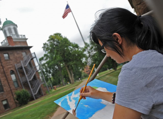 Victoria Lee, 17, of Danbury High School, painted the south side of South College. CCY is a program of the Capitol Region Educational Council and is sponsored in collaboration with Wesleyan's Center for the Arts. The approximately 150 high school students that come to Wesleyan for CCY reflect a diverse ethnic, economic, and cultural society. Students leave CCY with a better perspective on career and higher education choices.