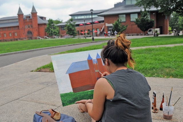 Paige Schmitt, 17, a rising senior at Watkinson School in Hartford, Conn. painted the Fayerweather building. Schmitt also is taking CCY classes on steel pan drums and Japanese Sumi-e painting this summer.