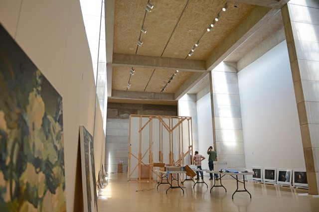 "The Center for the Arts is hosting ""The Alumni Show II"" exhibit Sept. 6-Dec. 8 in the Ezra and Cecile Zilkha Gallery. On Aug. 14, CFA staff worked to hang art featured in the show."