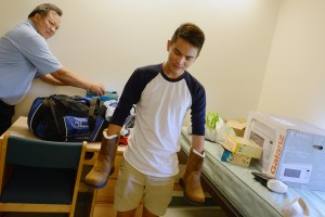 Hawaiian resident Rick Manayan '17 bought his first pair of winter boots in anticipation of a snowy New England winter. He moved into Clark Hall on Aug. 28 with help from his parents, Rick and Mae.