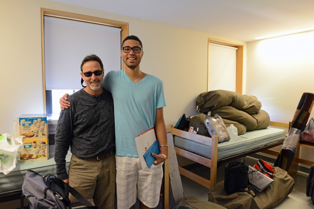 "Zachariah Ezer '17 moved into Clark Hall with help from his father Jonathan. Zachariah plays drums, piano ""and a little guitar."" They live in Houston, Texas."