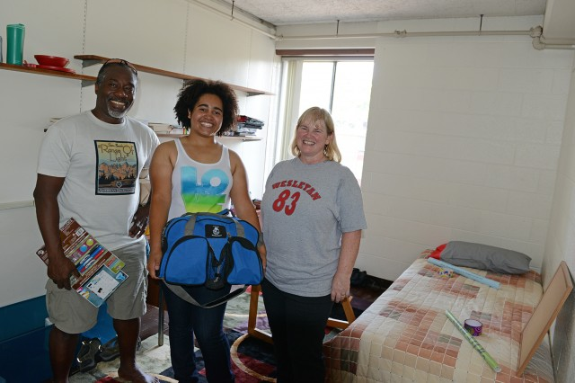 Howard Matthew and Megan Norris '83, chair of the alumni association, helped their daughter, Taylor, move into her new Butterfields residence. Megan made the bed, Taylor was unpacking her clothes and Howard's job was to hang items on the walls.