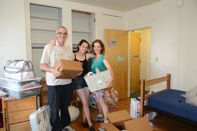 "John Eisner and Jennifer Door White P' 17 helped move their daughter, Hannah Wolfe Eisner '17 into her new 200 Church Street residence on Arrival Day, Aug. 28. More than a dozen orientation leaders and Residential Life staff helped carry in her belongings. ""We had everything in here in five minutes,"" John Eisner said."