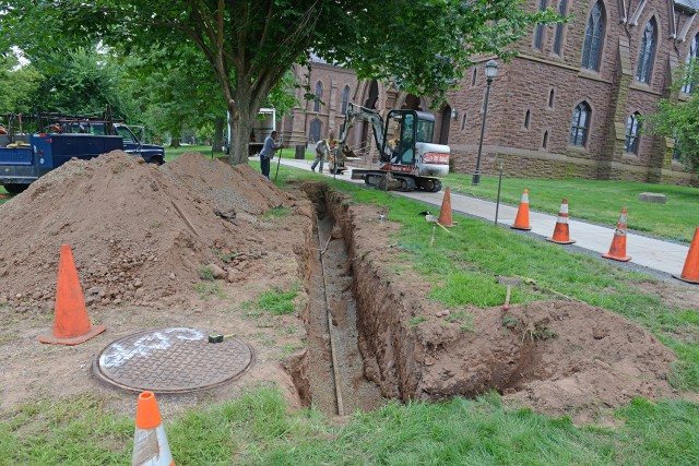 As part of Wesleyan's major maintenance projects this summer, Physical Plant- Facilities staff and local contractors inspected the manholes and made repairs to an underground piping system. On Aug. 7, crews discovered a failed drain line, which may be the cause of leaking vapors, visible during the colder months.