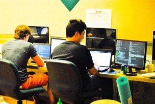 Students work on their programs during the Wesleyan Hackathon. (Photo by Shannon Welch '14)