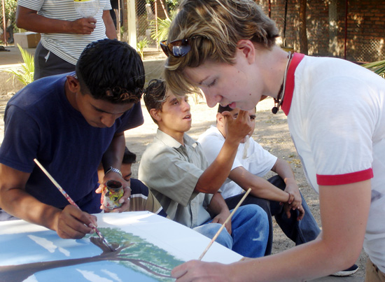 At right, Jessica French Smith ''09, paints a mural with students from Nagarote, Nicaragua. French Smith received a Projects for Peace grant, which will allow her and fellow Wesleyan students to return to the city this summer to build a community center.