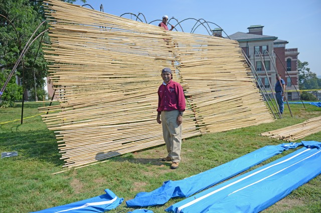 Prith Chuth, materials handler, unpacked dozens of bags of bamboo.