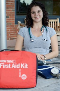 """Aviv Fraiman '15 is president of the WesEMT organization. She also works as a probationary EMT for the Haddam Volunteer Ambulance Service. """"I always carry my (EMT) bag with me. I never know when I'm going to need it."""""""