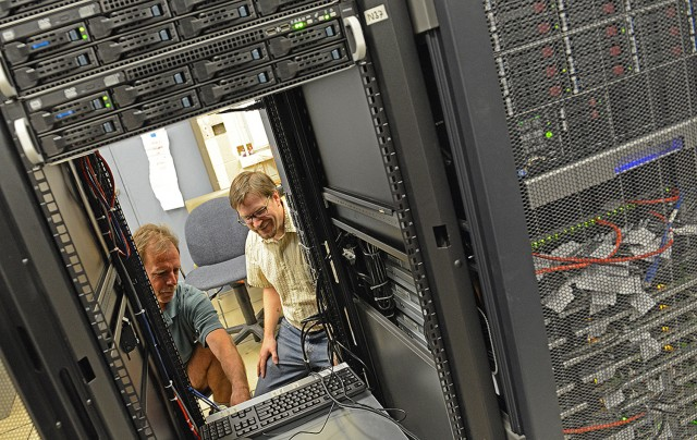 Henk Meij, unix systems group manager in Information Technology Services, and Francis Starr, professor of physics, look over Wesleyan's new high-performance computer platform, located on the fifth floor of ITS. The new cluster runs calculations up to 50 times faster than the previous cluster, installed in 2010. The new cluster also offers an additional 50 terabytes of disk space for a total of 100 terabytes.