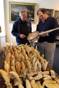 Stuart Frank '70 and photographer Richard Donnelly examine a whale bone banjo which was displayed earlier this year at the New Bedford Whaling Musuem.