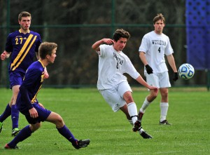 "Brandon Sousa '16 (#8) sends the ball up field while Ben Bratt '15 (#4) looks on during a NESCAC semifinal game vs. Williams.  Sousa and Bratt were both first-team all-NESCAC while Bratt also was academic all-NESCAC and all-sportsmanship.""  (photo by Peter Stein '84)."