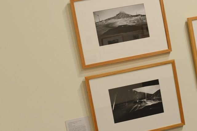 "The exhibit includes Garry Winogrand's (American, 1928-1984) gelatin silver prints ""Castle Rock, Colorado, 1960"" and ""Utah, 1964."" In these images, Winogrand did not photograph the automobile itself, but rather the view from the automobile. Stopping at Castle Rock, Colorado, Winogrand found the shadow of his car echoing the rock formation. A runaway steer crossing the road in Utah is seen through the windshield of a car stopped in its tracks. By using a wide-angle lens on a 35mm camera, Winogrand could combine rapid, instinctive shots with wide-ranging detail."