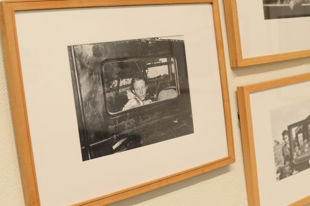 "On display is Russell Lee's  (American, 1903-1986) gelatin silver print of ""Migrant Child in a Car, Prague, Oklahoma, 1939."""